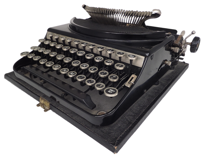 A sportswriters Monarch portable typewriter