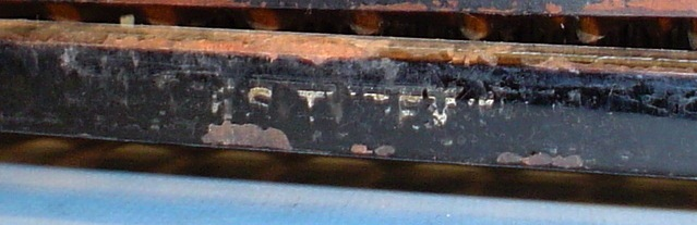 Faded lettering on base of Fay-Sholes