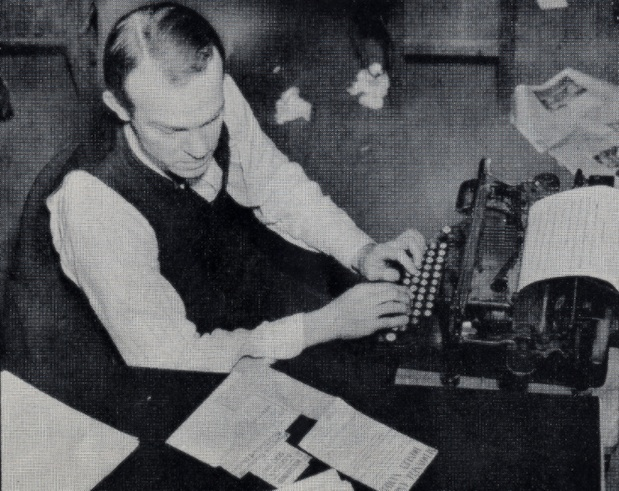 Reporter at typewriter - Cleveland Press